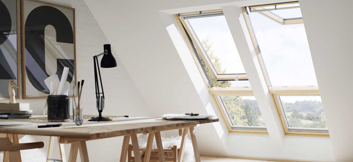 VELUX top hung roof windows in lacquered pine