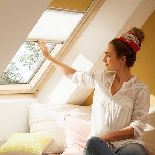 Blinds and screens being used on a VELUX roof window